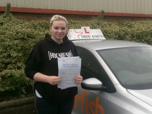 Gabbie with her Practical Driving Test Pass Certificate outside Weston-super-mare Driving Test Centre